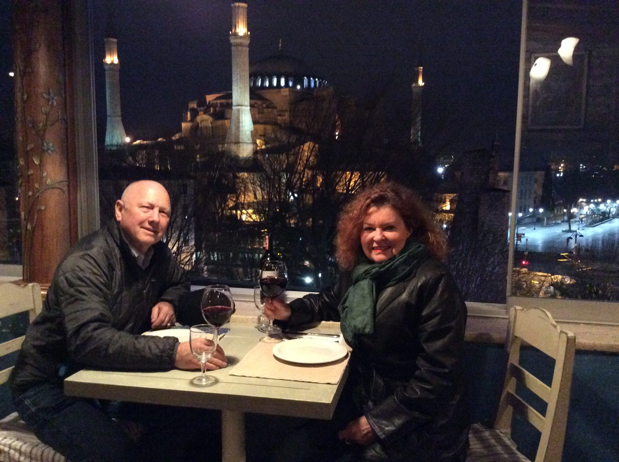 Jeannette and Roger Simon having dinner on the rooftop of the Dubb Indian restaurant in Istanbul- Hagaia Sophia in the background.